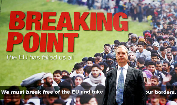 Nigel Farage standing in front of a racist UKIP advert for leaving the EU