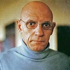 color headshot of Michel Foucault
