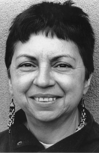 black and white headshot of Gloria Anzaldúa
