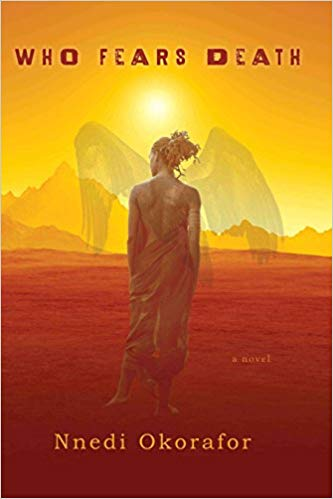 Cover of Who Fears Death; image of a woman with her back turned to us, facing an arid landscape and mountains; shadowy wings sprout from her back