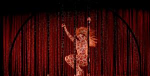 Beyoncé dancing on a stripper pole, leopard spots projected onto her body