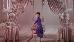 Lise (Leslie Caron), performing in illustration of Henri's description of her to Adam.