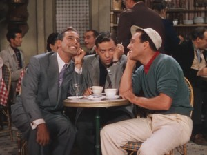 "Henri and Jerry begin to sing ""S'Wonderful"" in the 1951 film. Meanwhile, Adam (Oscar Levant) has just worked out that both are in love with the same woman, and nervously pounds coffee and cigarettes."