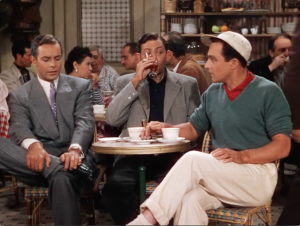 Adam (Oscar Levant) drinks and smokes his nervousness while Henri and Jerry discuss their personal lives all too openly.