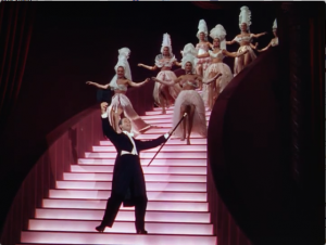 "Georges Guétary as Henri, singing ""Stairway to Paradise."""